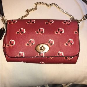 Coach crossbody deep red with floral details